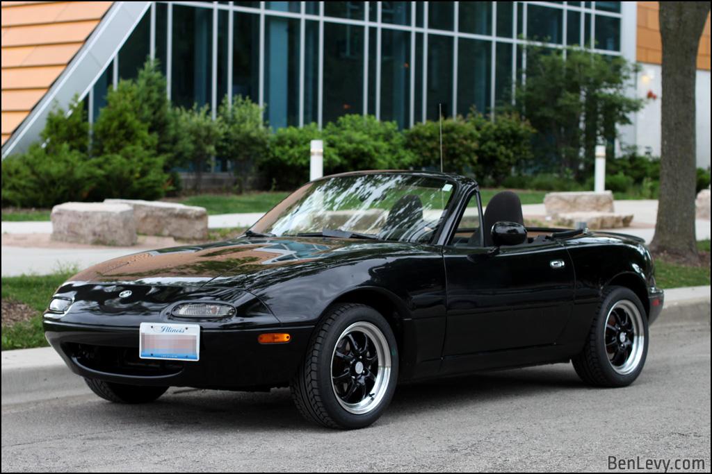 Black Enkei Classic J-Speed wheels on Miata
